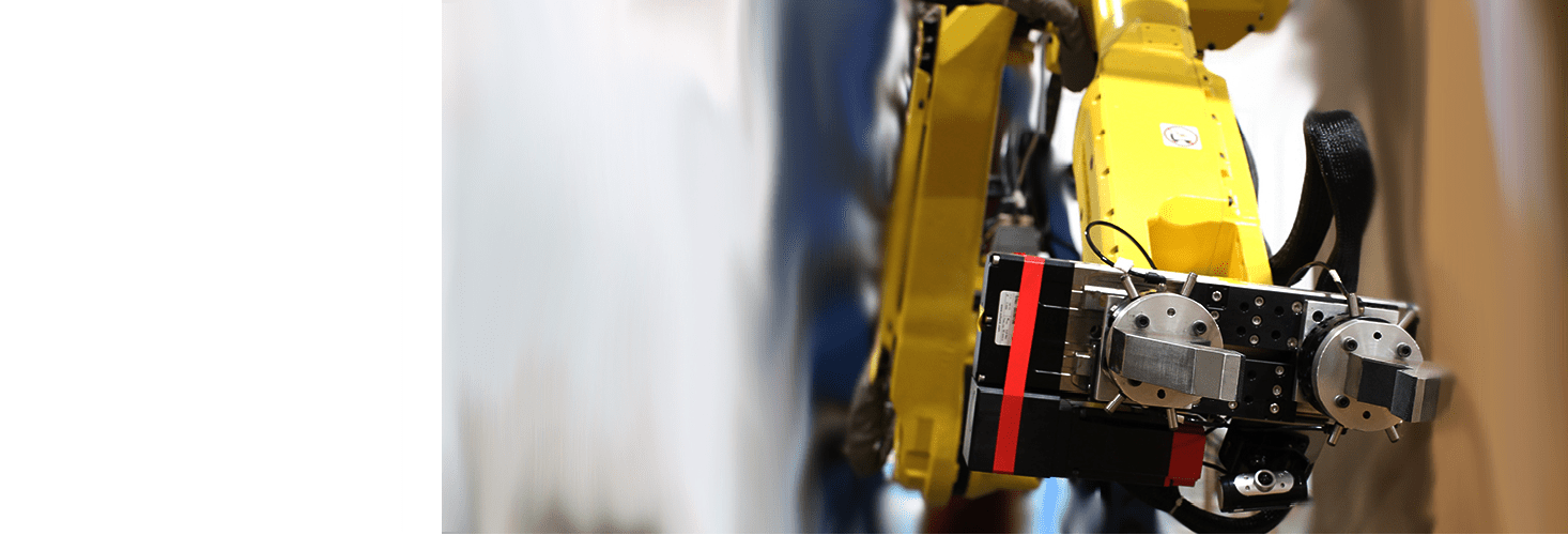 Fanuc robot with robotic gripper on the job